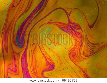 Psychedelic abstract formed by light reflecting off a soap bubble
