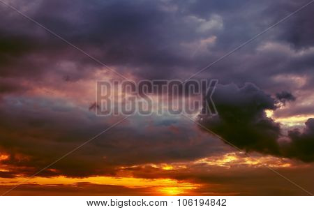 Fiery Orange Sunset With Storm Clouds