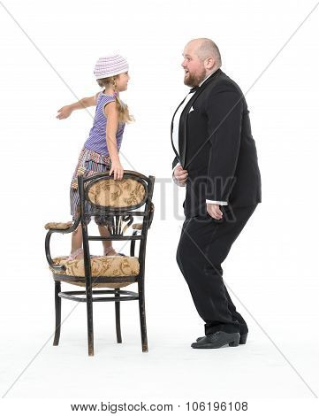 Little Girl And Servant In Tuxedo Have Fun