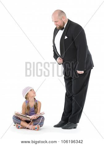 Little Girl And Servant In Tuxedo Looking At Each Other