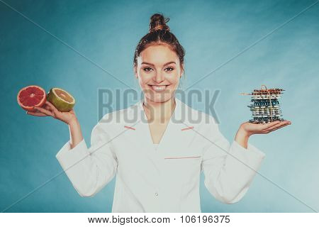 Woman With Diet Weight Loss Pills And Grapefruits.