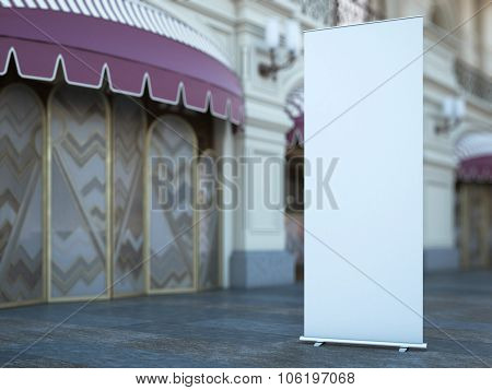 Blank roll up banner near old building. 3d rendering