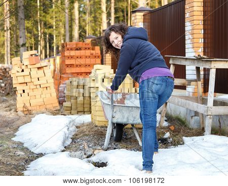 Young Woman Enjoys Work In Nature On Construction Site
