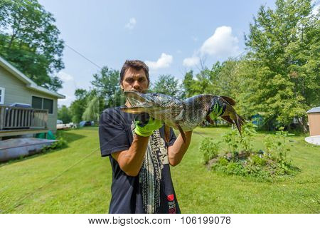 Fisherman holding Big pike
