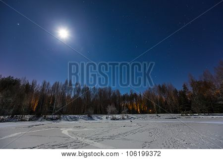 Mystical Frozen Winter Lake In Magic Moonlight At Star Night