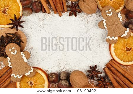 Holiday baking frame with gingerbread men, nuts, spices