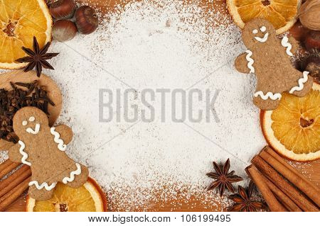 Holiday baking frame with gingerbread men, nuts and spices