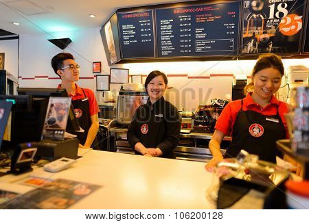 HONG KONG - OCTOBER 25, 2015: Pacific Coffee barista portrait. Pacific Coffee Company is a Pacific Northwest U.S.- style coffee shop group originating from Hong Kong