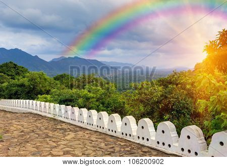 viewpoint on rainbow over valley from Buddha Rock temple in Dambulla, Shri Lanka