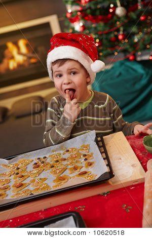 Small Boy Tasting Christmas Cake