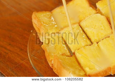 Bread And Butter In Plate On A Table