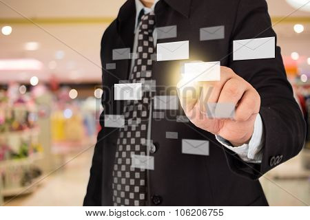 business man sending mail by pushing letter button on touch screen
