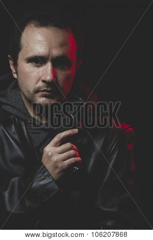 Expression, Man with intent to commit suicide, gun and leather jacket, red backlight