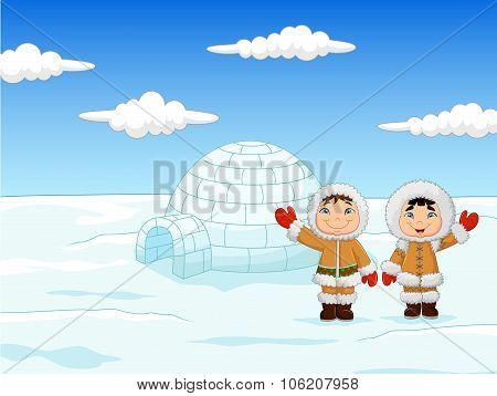Little kids wearing traditional Eskimo costume with igloo house
