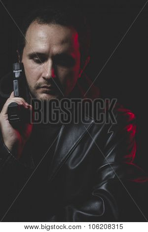 Problem, Man with intent to commit suicide, gun and leather jacket, red backlight