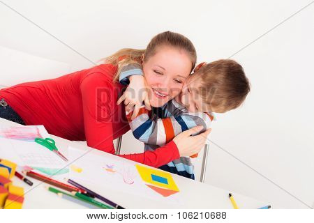 Happy child embrace his mother