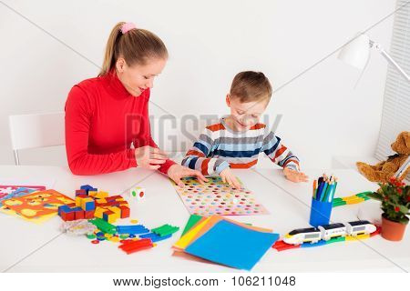 Mother and son playing  board game