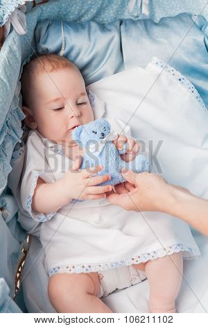 cute baby boy with plush toy