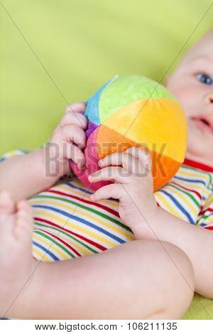 Little boy playing with soft ball