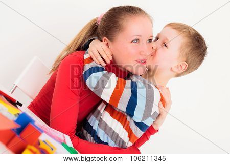 Child kising his mom