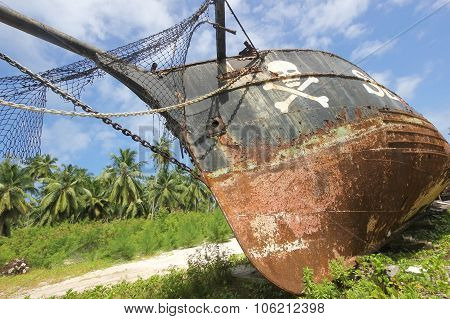 Rusty Old Pirate Ship On The Shore Of The Island. La Digue
