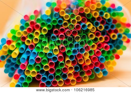 Colorful Straw Tubes Closeup. Abstract Texture And Background.on Wooden Table