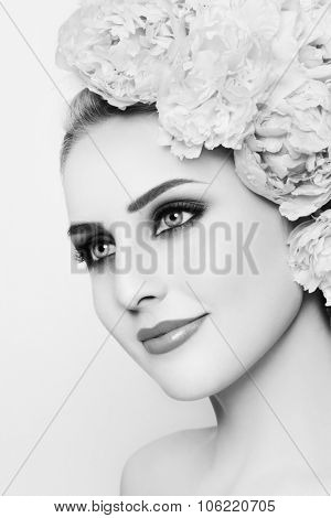 Black and white portrait of young beautiful woman with stylish make-up