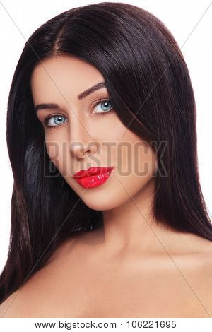 Young beautiful sexy tanned brunette with glossy red lipstick over white background