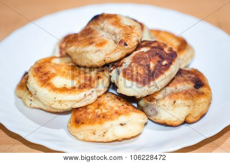 Golden Curd Fritters On White Plate