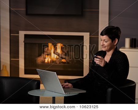 Woman Using Computer At Home