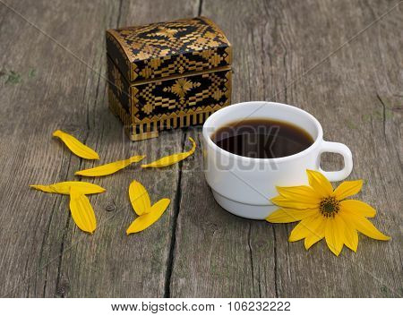 Cup Of Coffee, Petals, Casket And Yellow Flower, Still Life, On A Wooden Table