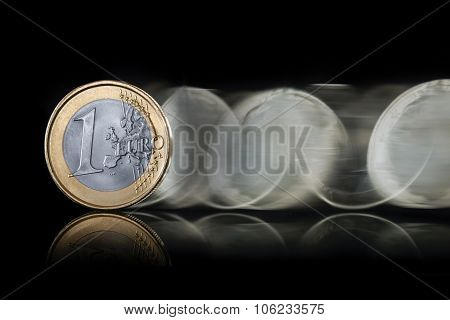 closeup of euro coin spin on dark background