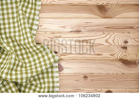 green tablecloth over wooden table
