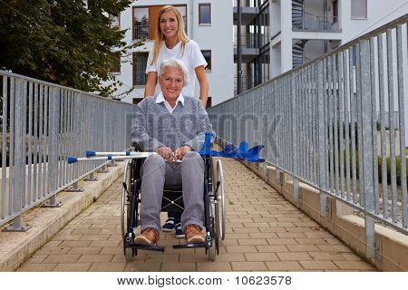 Woman With Wheelchair On Ramp