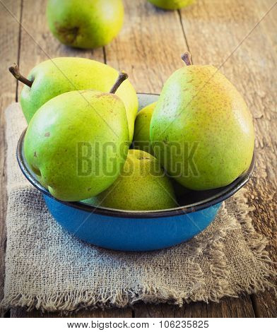 Green Pear In A Metal Bowl