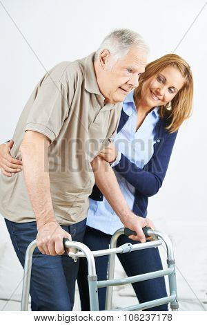 Physiotherapist helping old senior man in rehab
