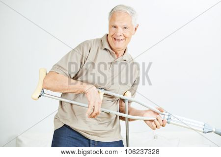 Old funny man playing air guitar with his crutches