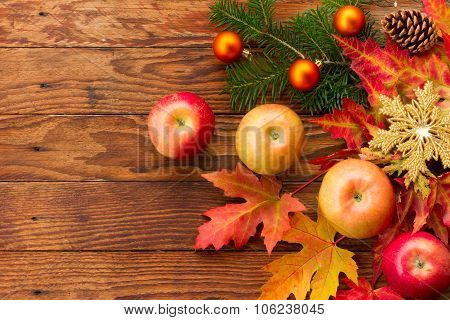 still life with apples and autumn maple leaves
