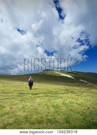 Woman Hiking Solitude On Mountain Meadow
