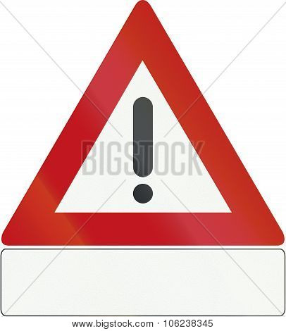 Netherlands Road Sign J37 - Danger. Details Of The Danger Are Shown On The Plate Beneath