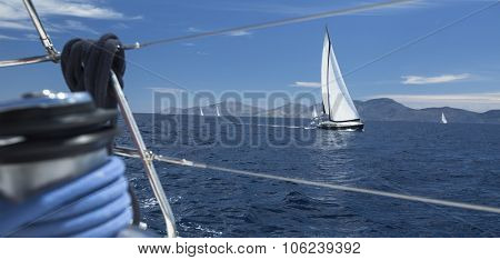 Sailing regatta. Ship yachts with white sails in the open Sea. Luxury boats.