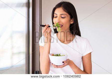 healthy indian woman eating green salad