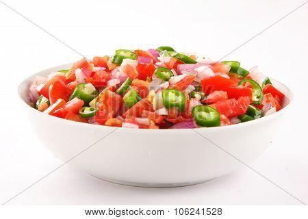 Bowl of fresh homemade tasty tomato salsa dip,