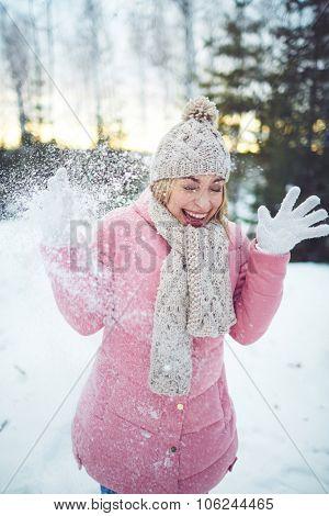 Laughing girl in winterwear having fun outside