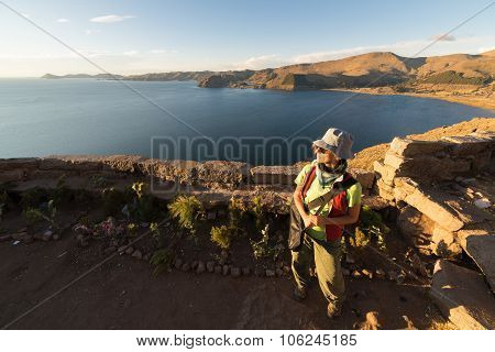 Tourist Looking At Sunset On Titicaca Lake, Bolivia