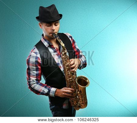 Saxophone player on blue background