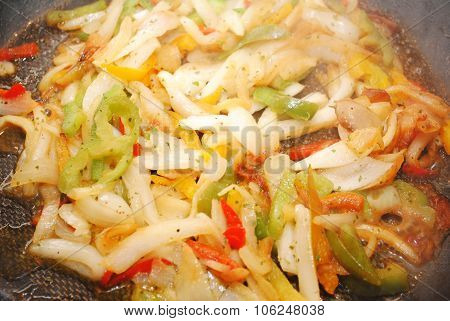 Fresh Onions & Peppers Cooking In A Pan