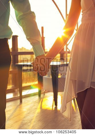 Woman And Man In Elegant Clothes,holding By Hands And Posing On Sunset