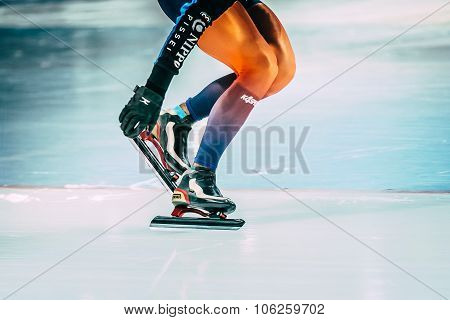 girl athlete speed skating shoveling snow with skate blades