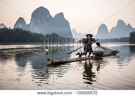 traditional cormorant fisherman on Li river near Xingping, Guangxi province, China.